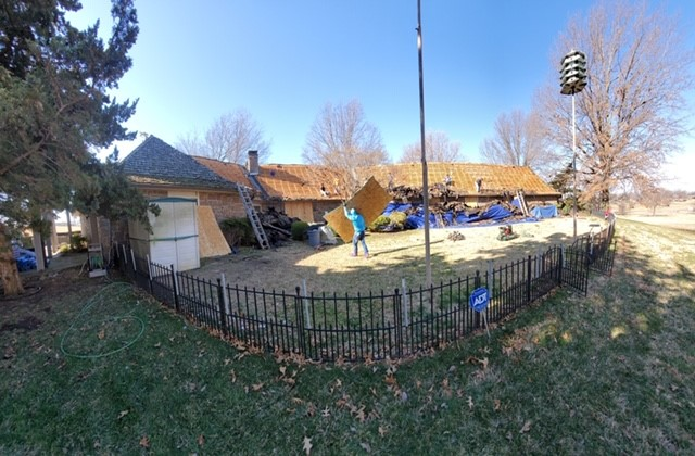 Grove, OK - This is our work in progress! We have most of the wood shakes removed and are working to get the new decking installed.