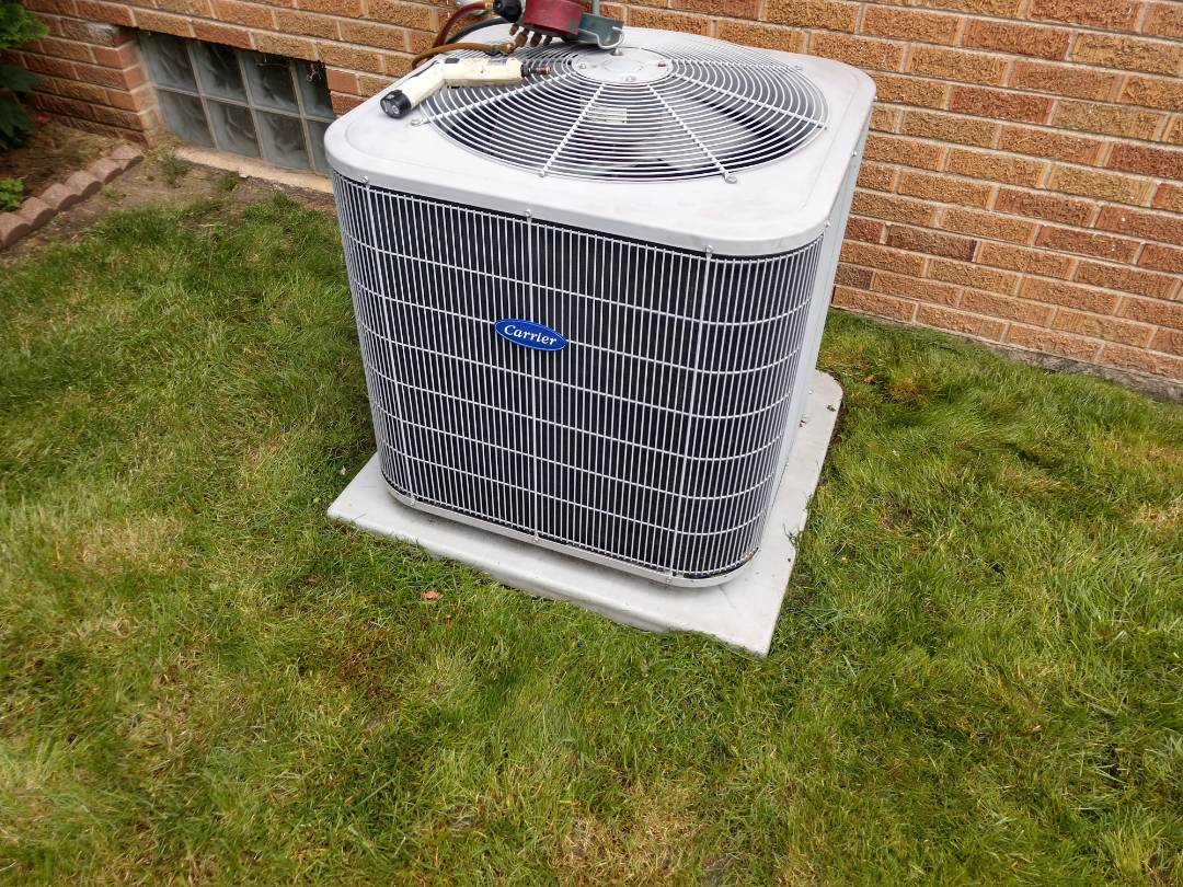 Mount Prospect, IL - Ac service call. We diagnosed and replaced the dual capacitor on a Carrier air conditioner.