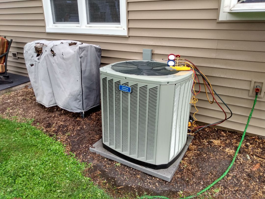 Elk Grove Village, IL - Performed AC maintenance on an American Standard 4TTB air conditioner. Replace an Aprilaire 413 furnace filter. Air conditioning tune up in Elk Grove Village.