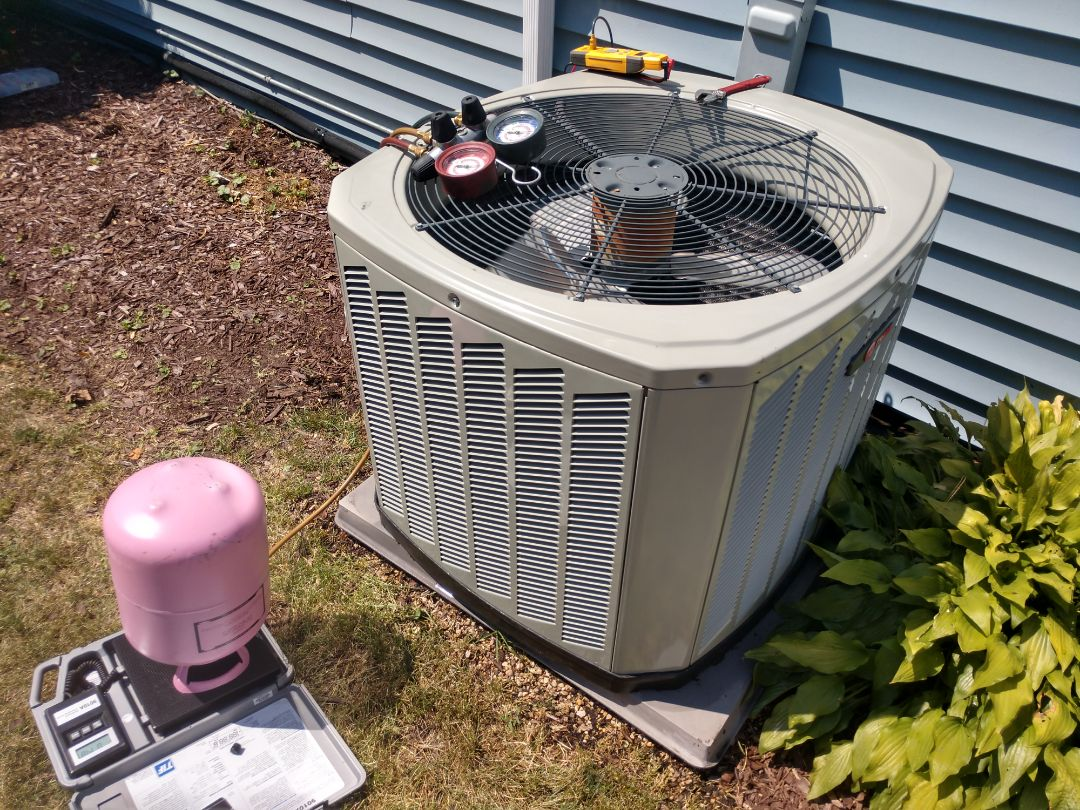 Mount Prospect, IL - Ac no cool service call. We repaired a Trane air conditioner by replacing a dual capacitor, recharging the Puron refrigerant and cleaned the condenser coil