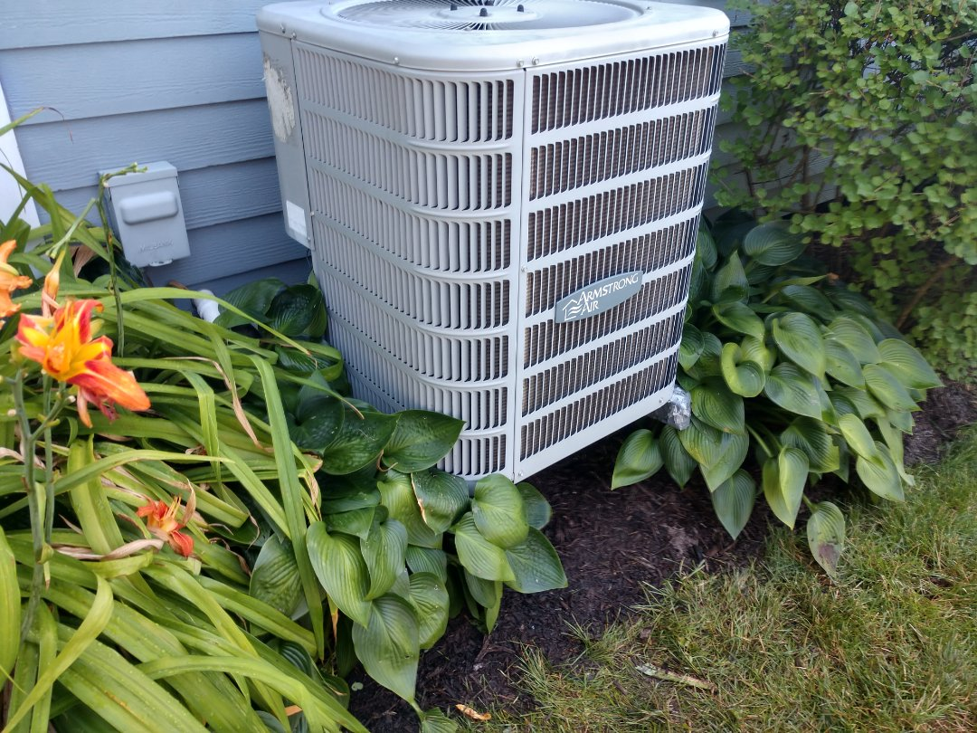 Mount Prospect, IL - Ac maintenance. We performed a cleaning on an Armstrong air conditioner. We also replaced the dual capacitor.