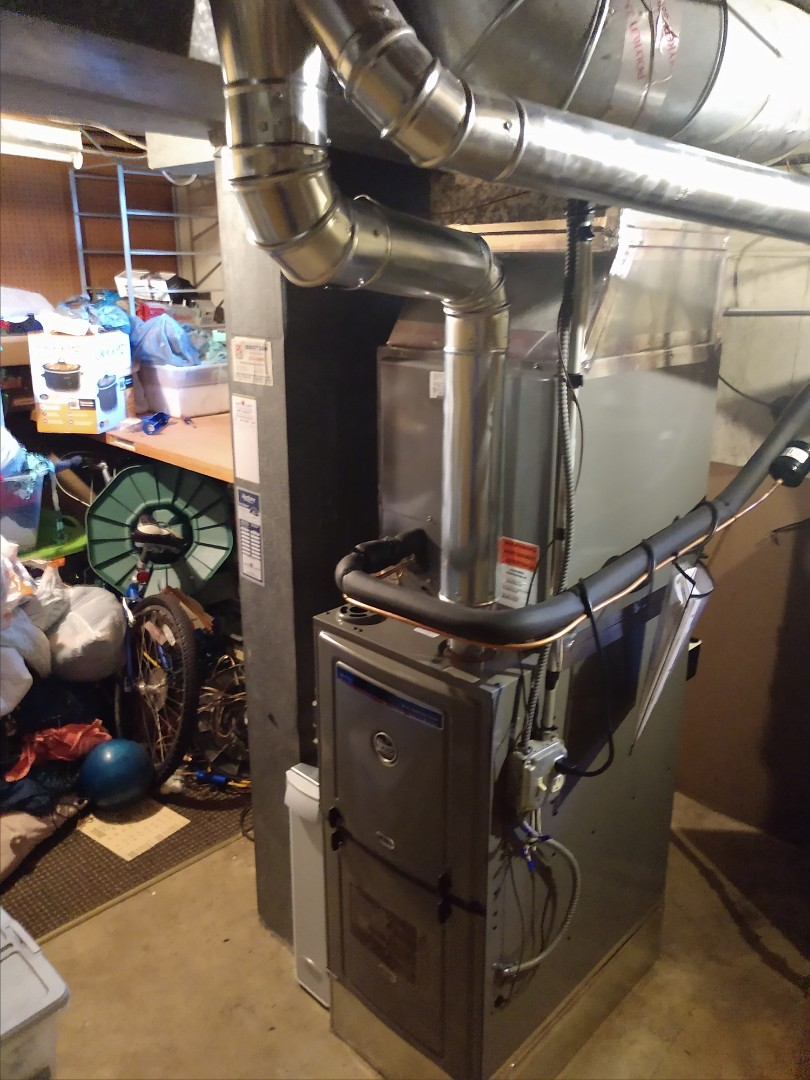 Mount Prospect, IL - We installed a Ruud u802v 80% furnace, ra14 air conditioner, Aprilaire 600 humidifier and 1000 series air cleaner