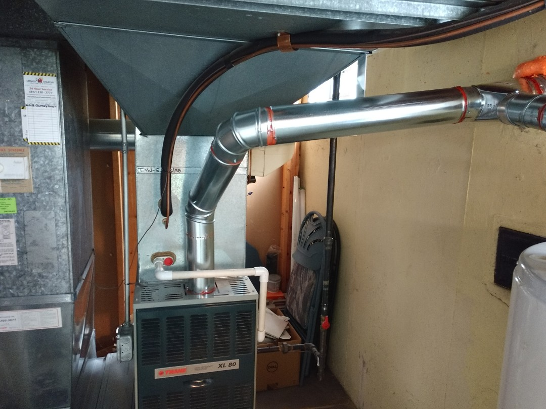 Mount Prospect, IL - We installed a chimney liner for Trane 80% furnace and replaced all of the flue pipe