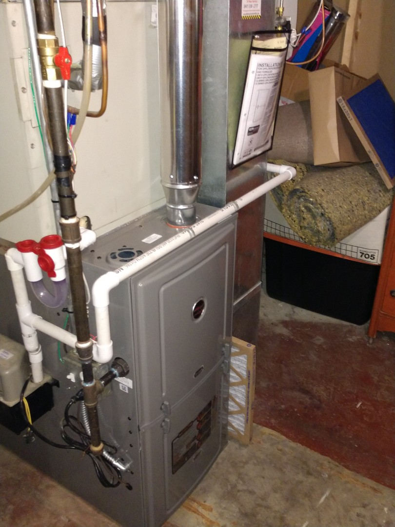 Mount Prospect, IL - Furnace installation. We installed an 80% Ruud R801s Furnace