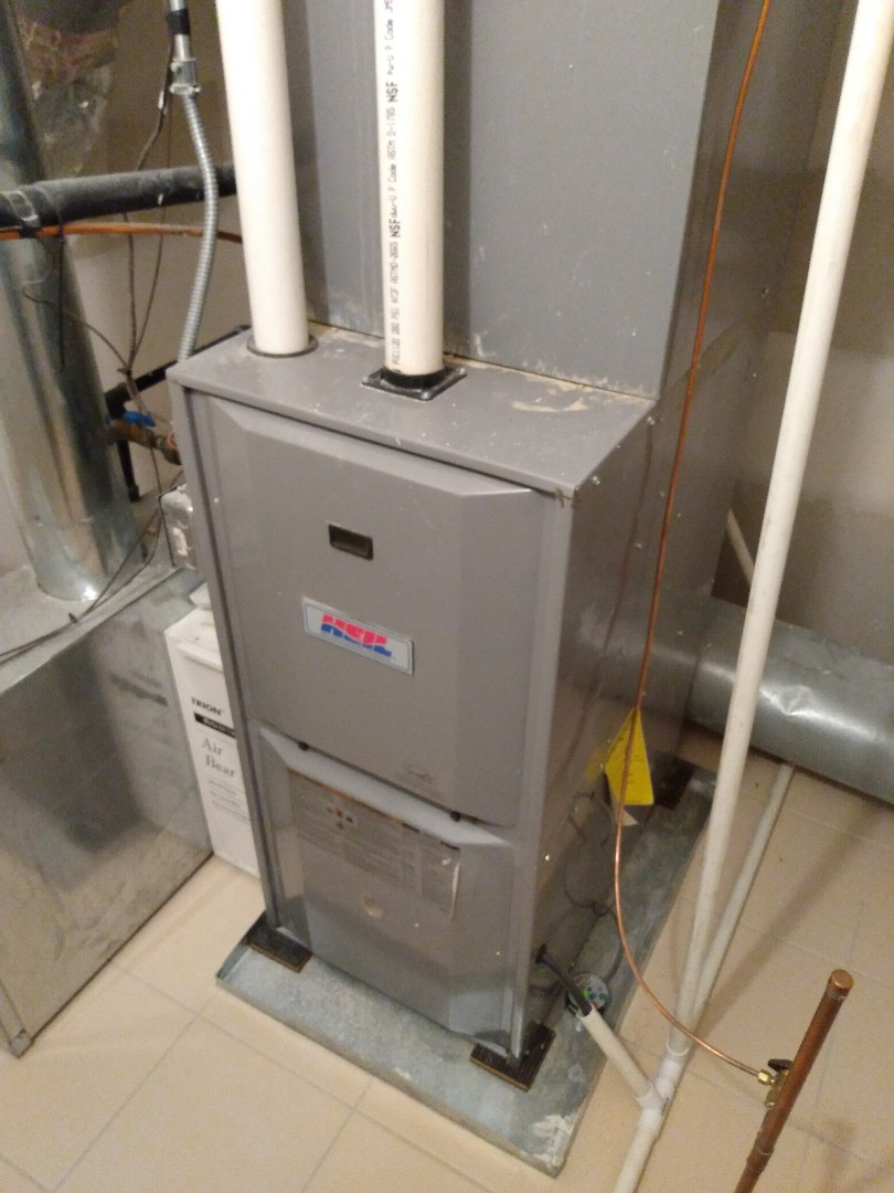 Medinah, IL - Annual furnace maintenance on two Heil furnaces. Replace Aprilaire humidifier pad in Medinah.