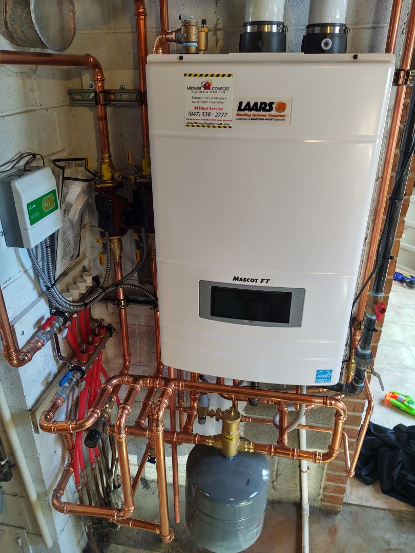 Mount Prospect, IL - Tankless boiler installation.  We replaced the existing heating boiler and water heater and replaced it with a Laars mascot ft combi heater
