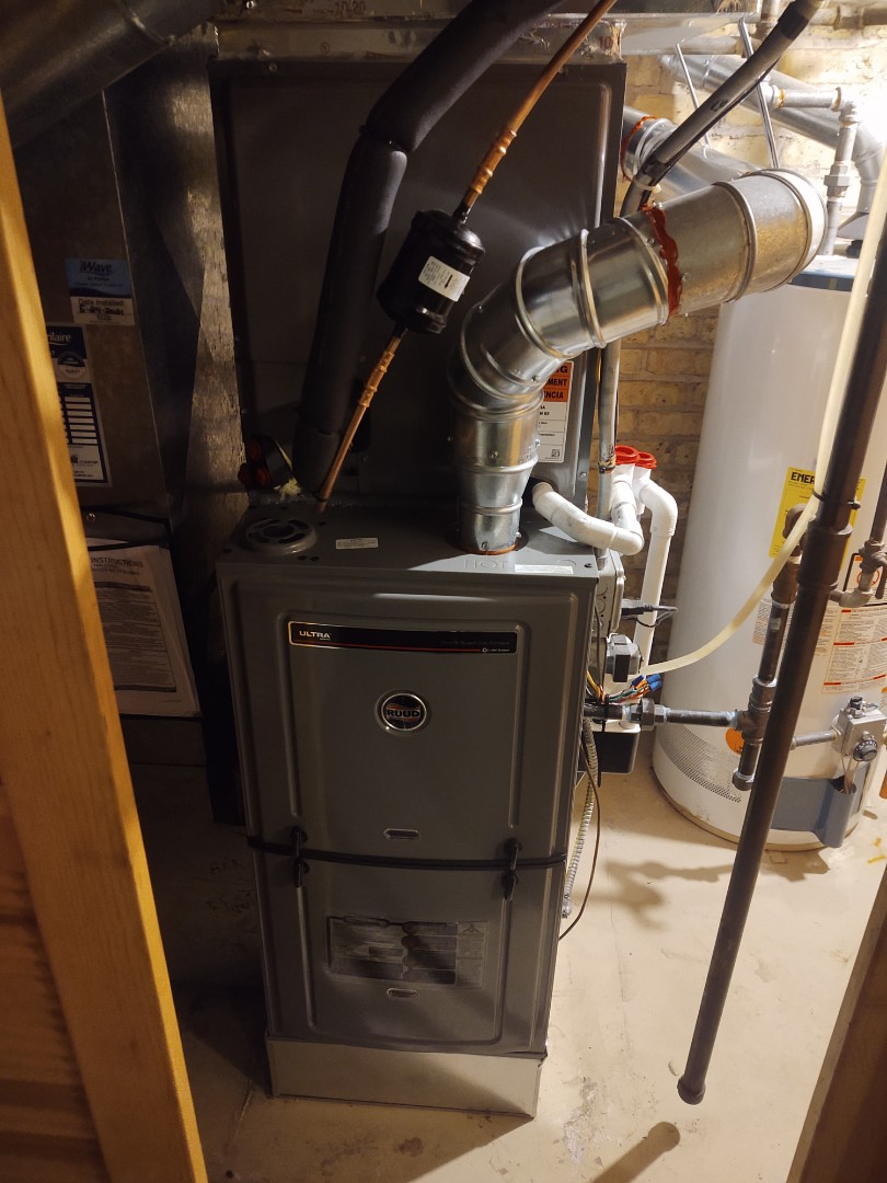 Mount Prospect, IL - HVAC installation We installed a Ruud u802v 2 stage variable 80% furnace with an RA16 16 SEER air conditioner with matching indoor coil. For indoor air quality, we installed an Aprilaire 500 humidifier and I wave air purifier