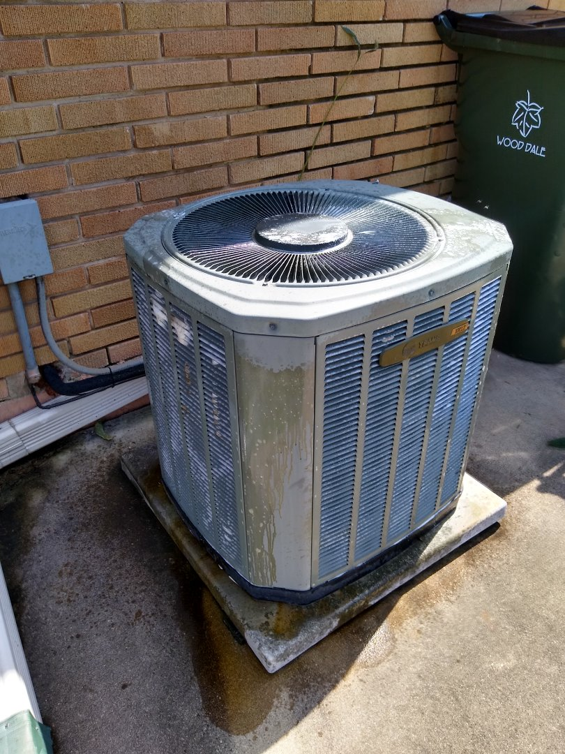 Wood Dale, IL - Service call for Trane ac not working. Found a bad dual capacitor. Checked refrigerant levels and cooling efficiency. Found low run capacitor on the Trane furnaces blower motor. Also cleaned the condenser coil as it was very impacted and dirty.