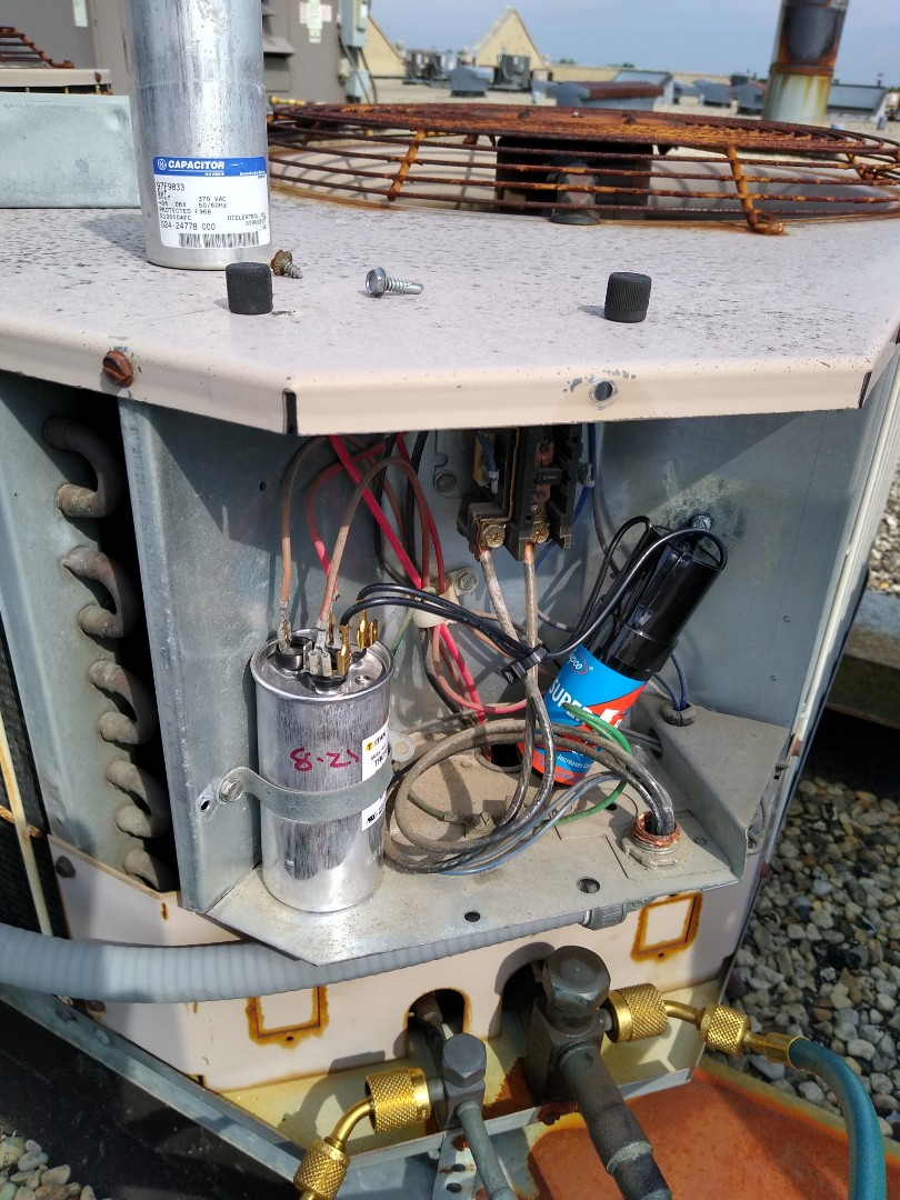 Mount Prospect, IL - Service call for air conditioner blowing warm air. Found a blown dual capacitor in the York condenser, and replaced it. Also put a hard start kit on to give the compressor a bit more longevity.