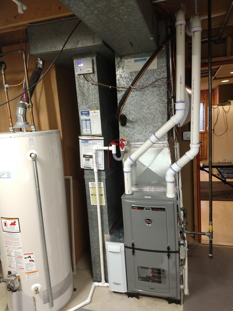 Des Plaines, IL - Installed an aerus air scrubber ultraviolet photocatalytic air purifier to help with indoor air quality. Installed on Ruud 96% furnace. Changed out aprilaire humidifier pad and filter.