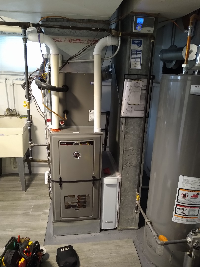 Mount Prospect, IL - Preventive maintenance and tune up on Ruud 96% high efficiency furnace that we installed. Replaced aprilaire Merv 11 filter and humidifier pad