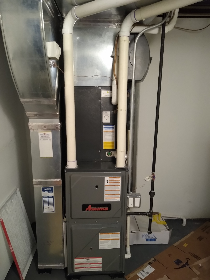 Mount Prospect, IL - Furnace tune up on 90% efficiency Amana unit. Replaced filter and water pad for humidifier