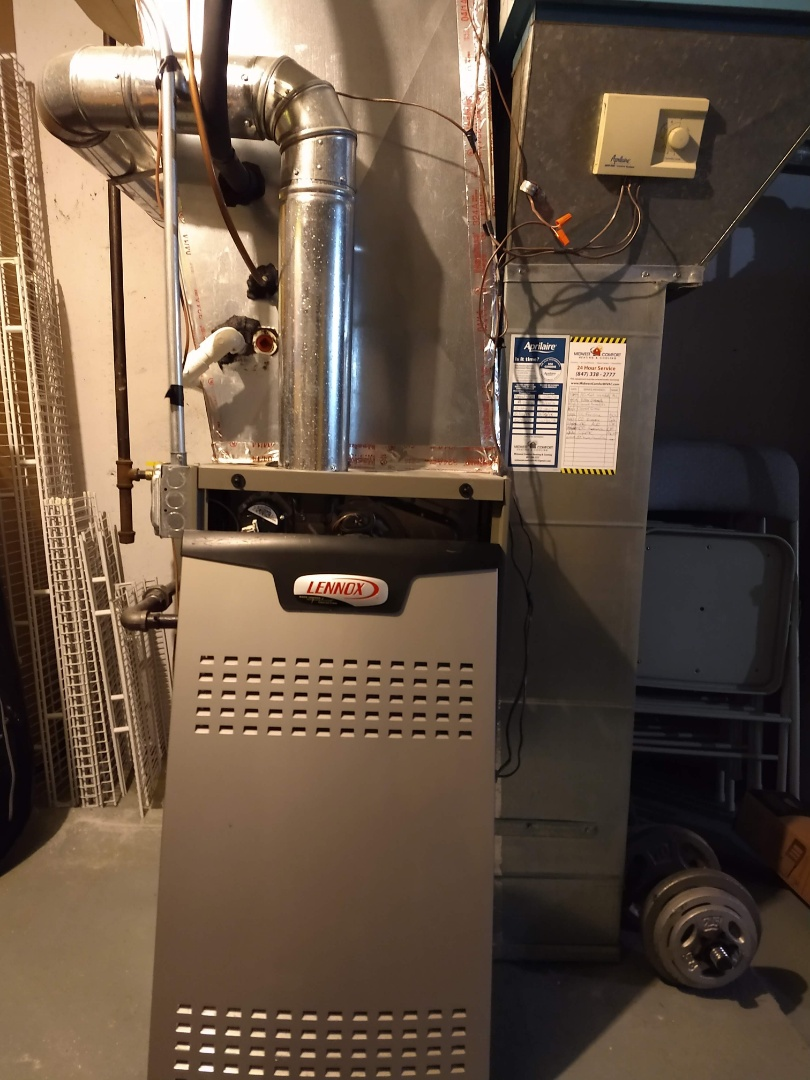 Arlington Heights, IL - Condensate pump install. Also replaced old rotting elbows on flue. And did a furnace tune up on a 15 year old 80% efficiency lennox
