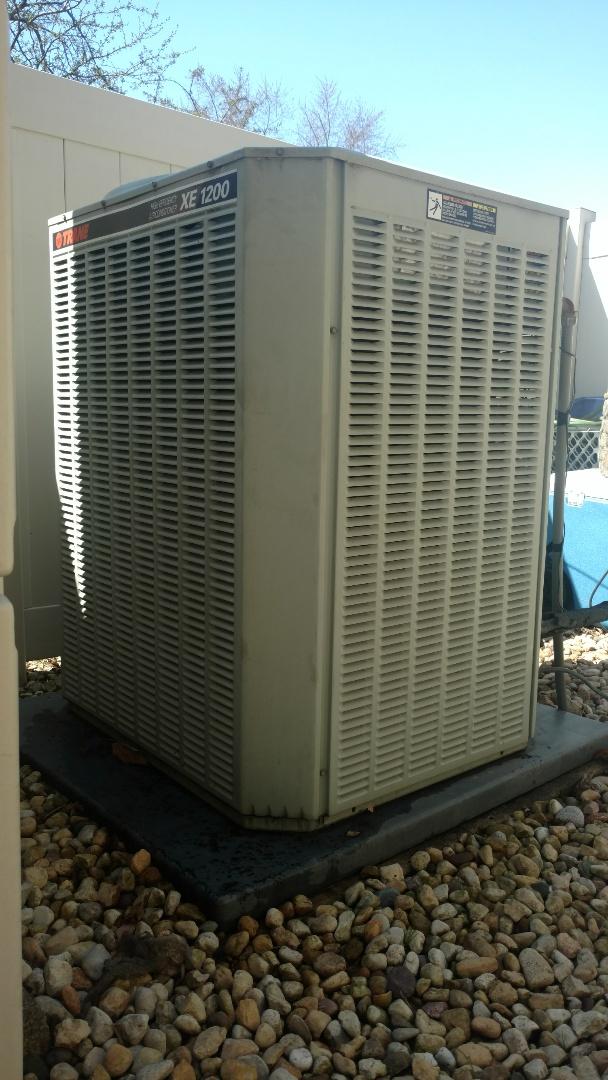 Mount Prospect, IL - Air conditioner maintenance call. Performed air conditioning maintenance on Trane unit.