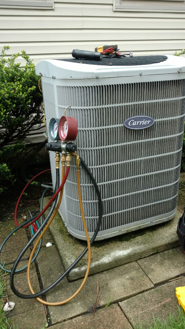Mount Prospect, IL - Air conditioner service call. Performed air conditioning repair on Carrier unit.