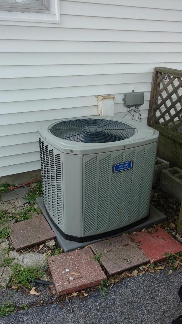 Des Plaines, IL - Air conditioner maintenance call. Performed air conditioning maintenance on American Standard unit.