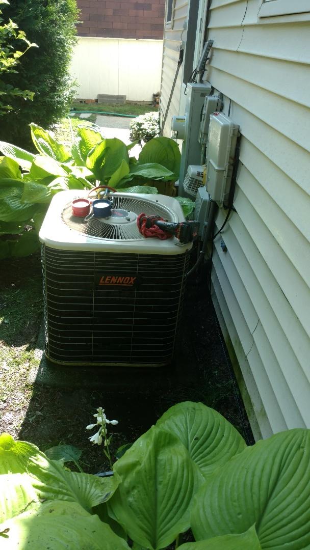 Mount Prospect, IL - Air conditioner maintenance call. Performed air conditioning maintenance on Lennox unit.