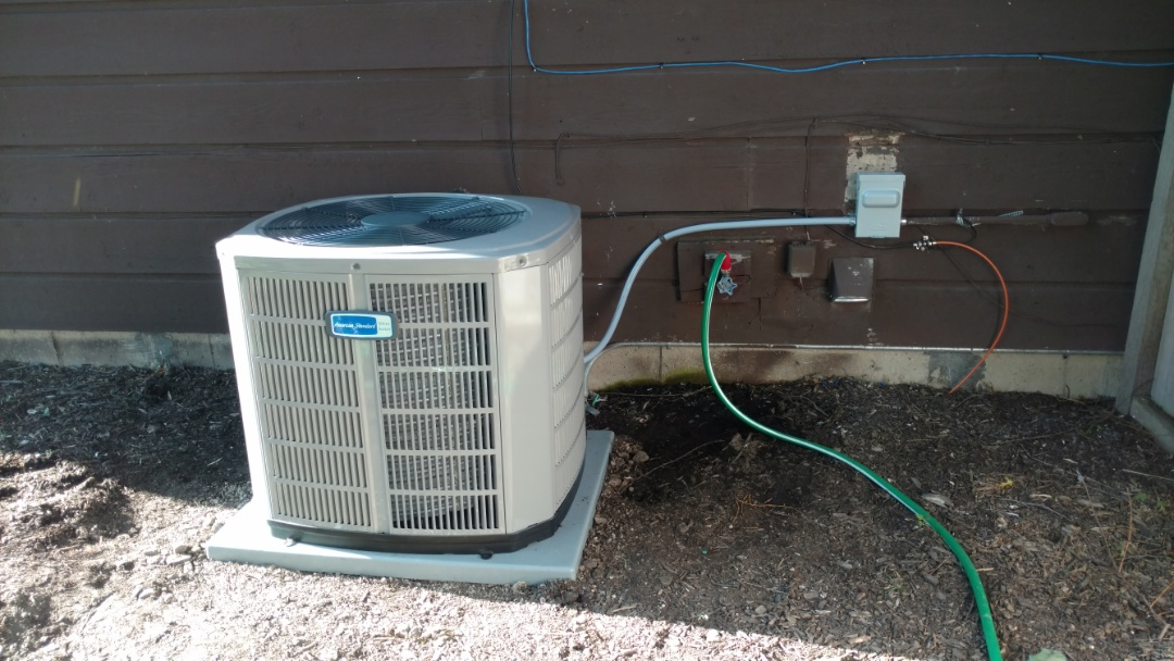 Palatine, IL - Air conditioner installation call. Performed air conditioning installation on American Standard unit.