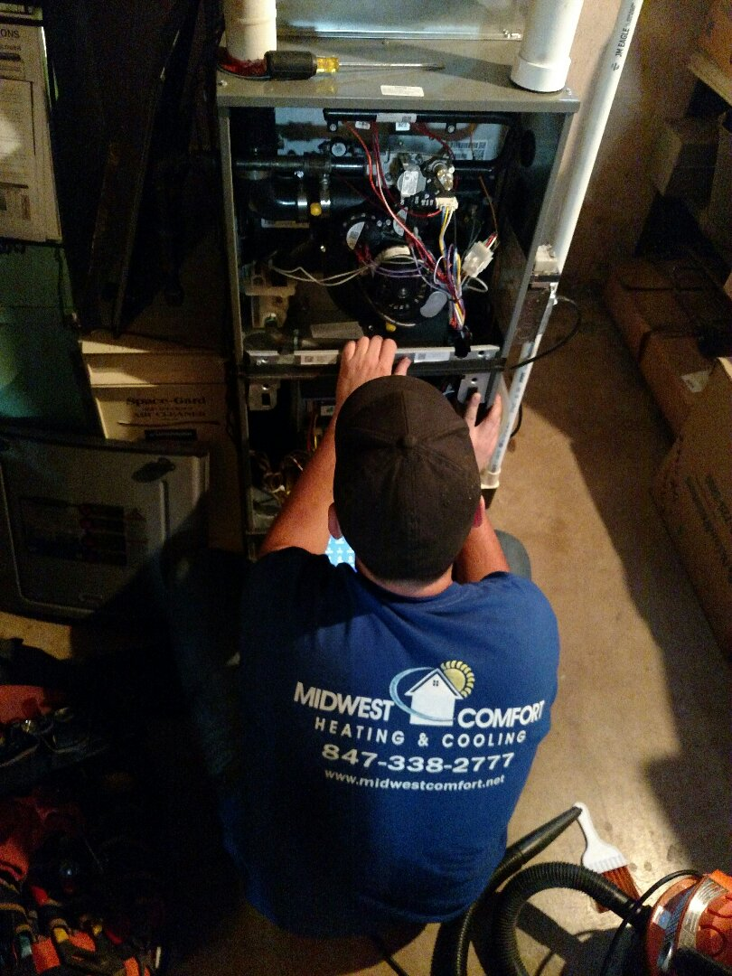 Des Plaines, IL - Clean and check Ruud furnace. Annual furnace maintenance in Des Plaines