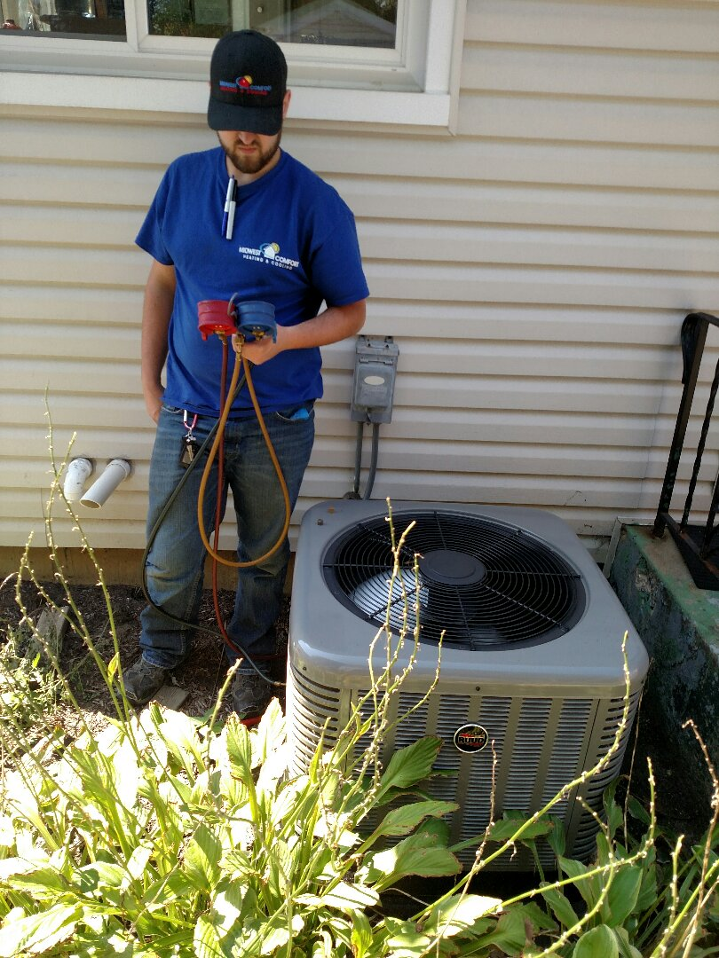 Palatine, IL - Clean and check Ruud furnace and AC. Annual furnace and air conditioning maintenance in Palatine.