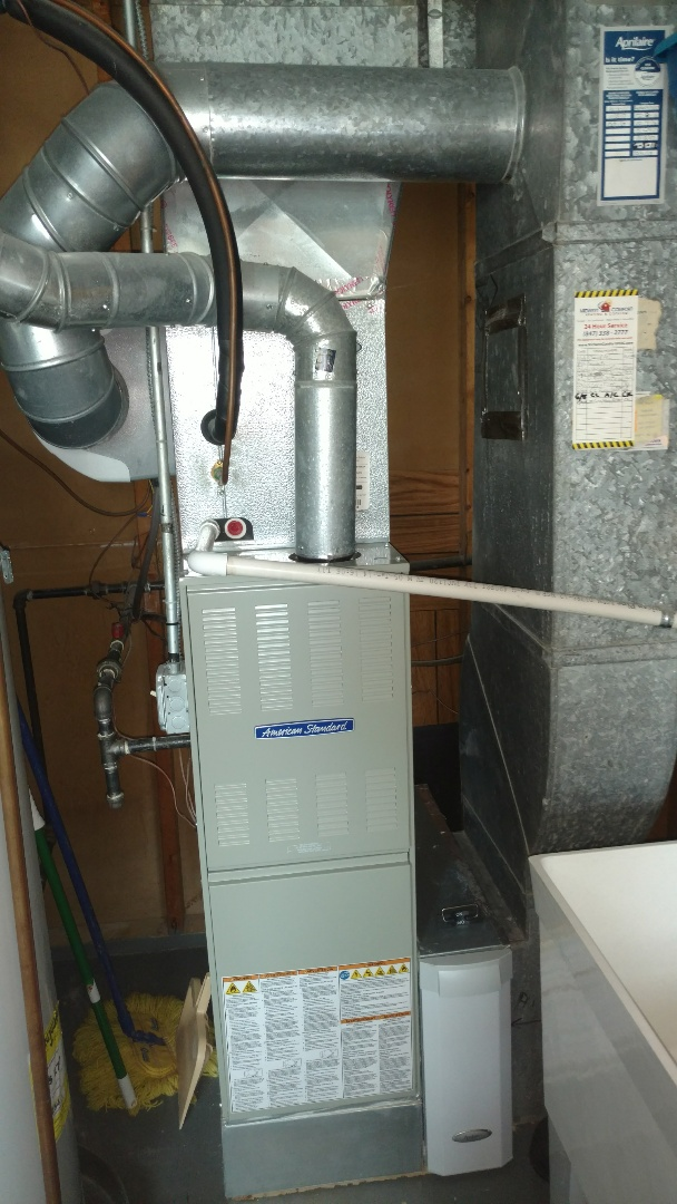 Mount Prospect, IL - Furnace and humidifier maintenance call. Performed furnace and humidifier maintenance on American standard and Aprilaire units.