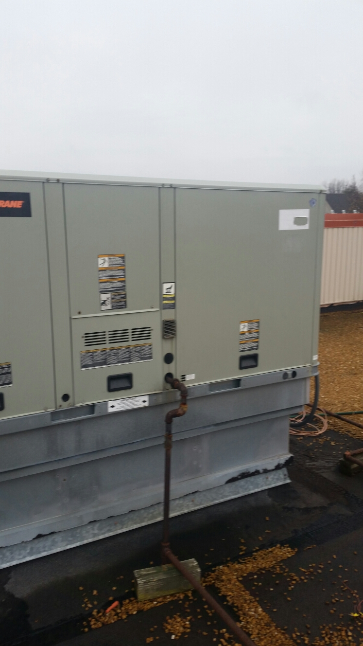 Ellisville, MO - Performing routine fall maintenance on trane package unit