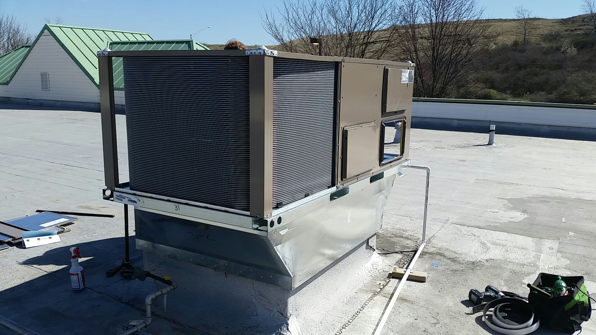 Maryland Heights, MO - Installing roof top unit