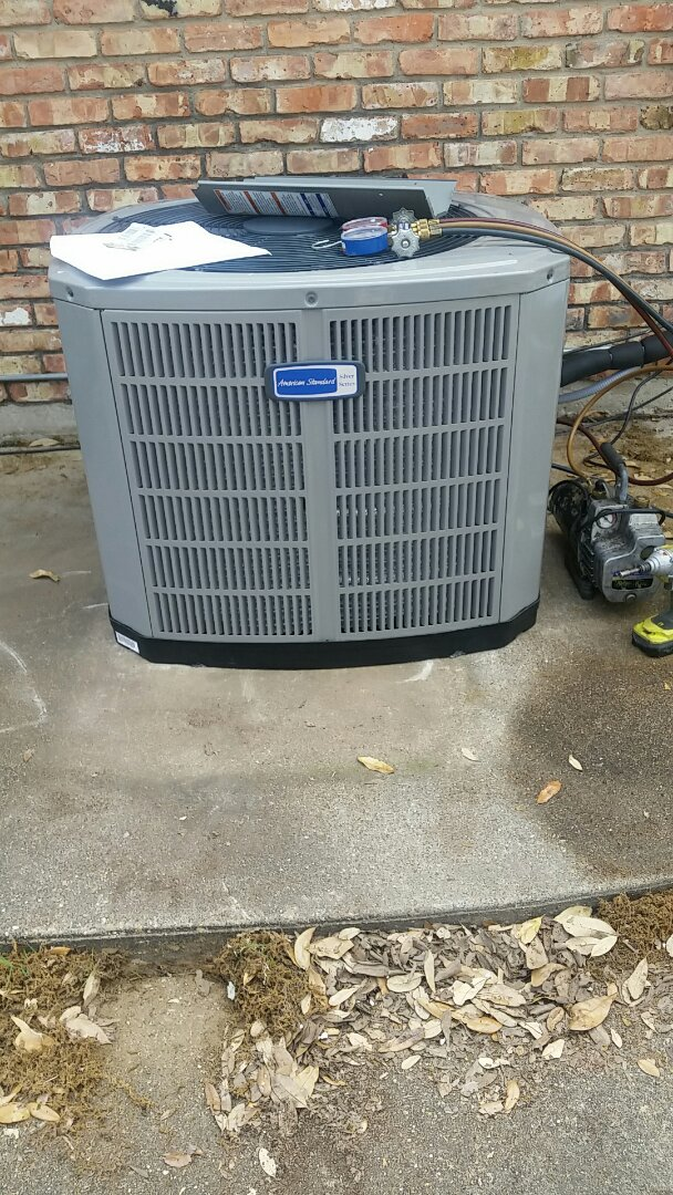 Rowlett, TX - Installing a new American Standard Heating and cooling system.