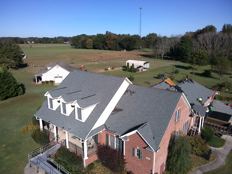 Hazel Green, AL - Starting the week off great and replacing a storm damaged roof in Harvest Alabama this is going to be quite the transformation from Thompson Roofing and Construction