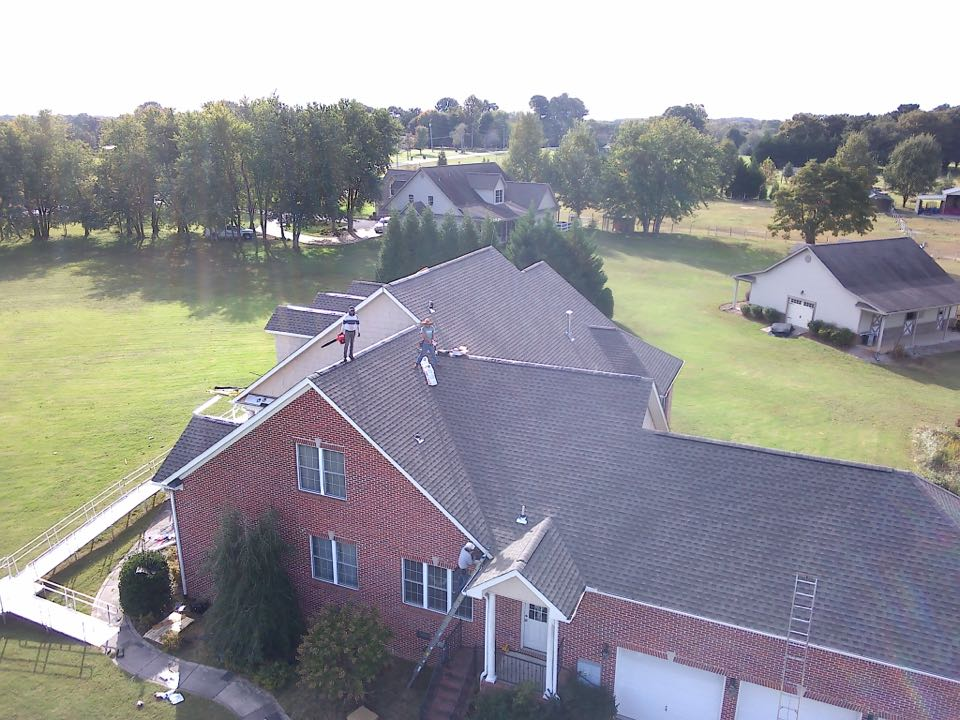 Hazel Green, AL - Almost wrapped up this residential roof replacement in Harvest, Alabama on this beautiful property. Thompson Roofing and Construction helped navigate the insurance claim process and this entire roof and gutter was covered by insurance. Just a clean up and final inspection and the job is ready for finalization. Do you need help finding a quality roofing recommendation?