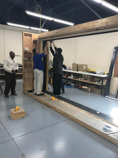 Warroad, MN - Jared Forde learning to install Multi-slide and bifolding Marvin doors at Marvin Window's event.