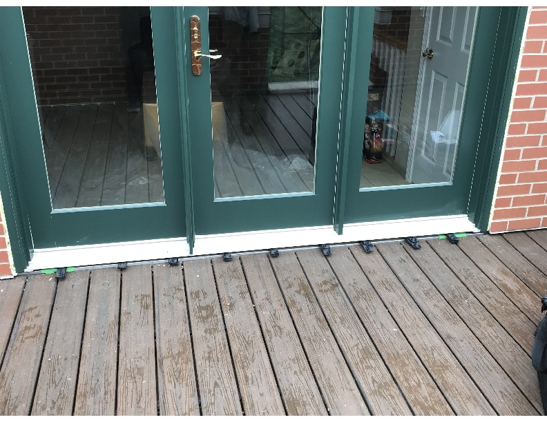 Chicago, IL - Just finished two 3-wide french in l-swing doors on a 4th story balcony. Wood doors with an aluminum-clad exterior from Marvin.