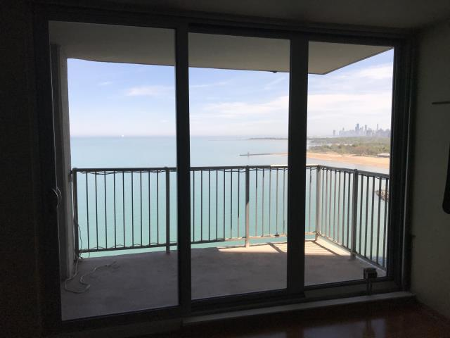 Chicago, IL - Triple wide Aluminum sliding door on a balcony right on the lake! We knocked won a partial wall and old windows/doors to put this slider in.