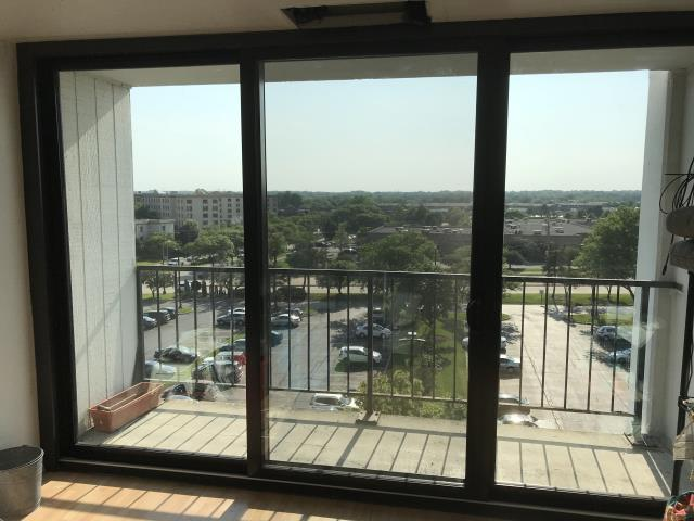 Lombard, IL - Quaker aluminum glass doors with high efficiency glass for solar control. Floor to ceiling in high rise building