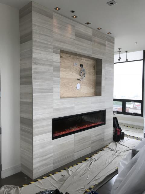 Chicago, IL - Isn't this fireplace a beauty? We bumped out a concrete wall to allow for the flush mounted fireplace and T.V. combo with a sound bar!