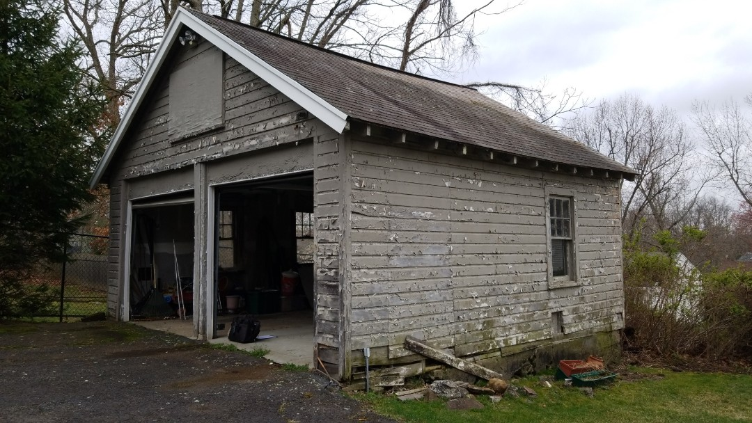 Livingston, NJ - This garage knees siding and a roof in Livingston New Jersey