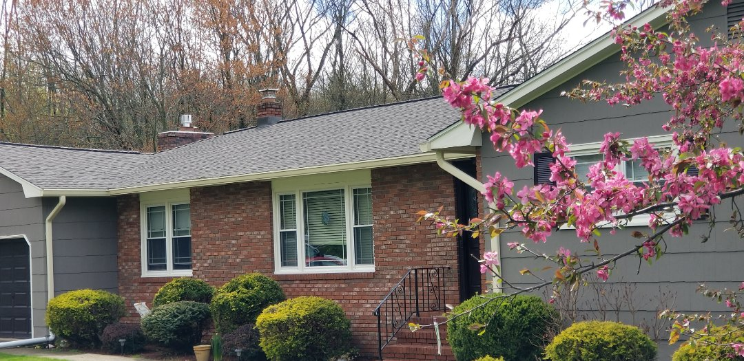 Denville, NJ - Installed a new GAF Timberline roof in barkwood with snow country ridge vent in Denville New Jersey
