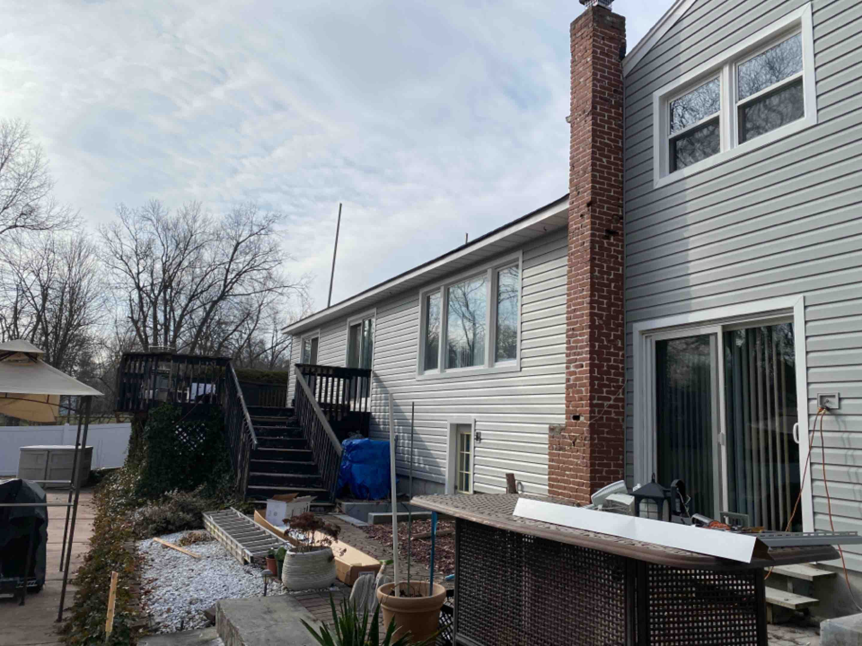 "Livingston, NJ - Installing new Alside Cape Cod Grey Coventry double 5"" Dutchlap vinyl siding in Livingston, NJ. We are using J-less casings around the windows and doors."