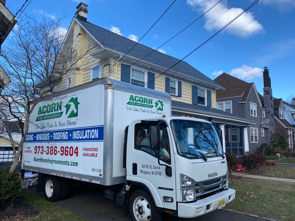 Maplewood, NJ - The crew is installing rigid insulation on the bottom of the joists in a crawl space, then they will dense pack cellulose insulation into the hoist cavities. This project is taking place in Maplewood, NJ.