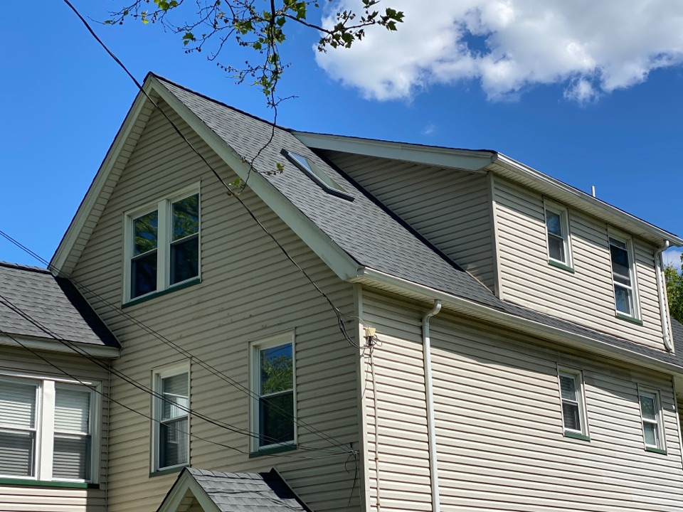 Summit, NJ - New GAF roof and a Velux skylight with solar powered blinds. We used Charcoal Timberline HDZ shingles following the Weather Stopper System with the Golden Pledge Warranty.