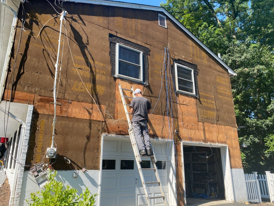 """Morristown, NJ - Working with NJIT, BASF & Oak Ridge National Lab installing a 1"""" insulated WRB under Hardie Plank siding & testing the WRB's effect on the home's thermal performance. Also installing relative humidly & temperature sensors on the home."""