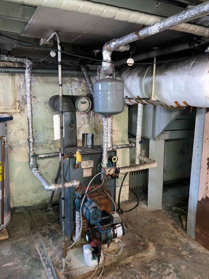 Replacement of hot water boiler, oil to gas conversion in  Roselle Park.
