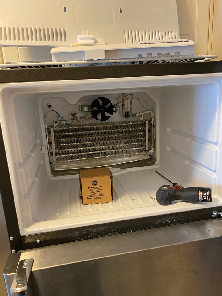 Replaced freezer evaporator fan motor on GE refrigerator that was not cooling.