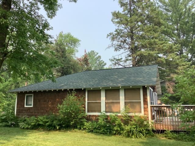 Nisswa, MN - Roof replacement with GAF Timberline HDZ shingles in the Hunter Green color on this house in Nisswa, MN.