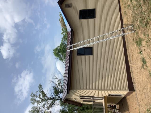 Crosslake, MN - Installing new Image II Standing Seam metal on this house in Crosslake, MN.