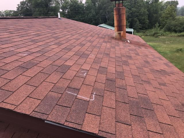 Aitkin, MN - Checking for hail damage on this roof in Aitkin, MN.