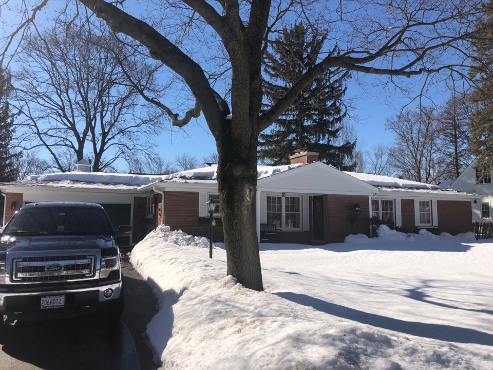 Golf, IL - We were able to come out on short notice to remove excess snow and ice around the perimeter of this lovely ranch house and golf to help protect against ice damning during the severe weather event
