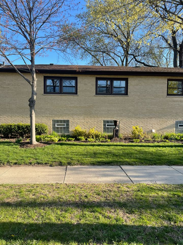 Arlington Heights, IL - Just started a roof, soffit, fascia and gutters here in Arlington Heights. We are also replacing the windows. Everything will be black.