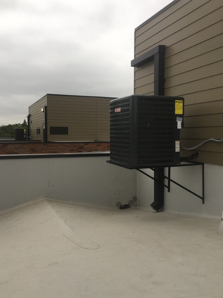 Dallas, TX - Checking condensers on the roof on cedar springs oak lawn area.