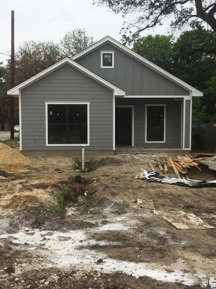 Corsicana, TX - Installing ac supply grills and returns on one of our many new construction homes that we do HVAC work on.